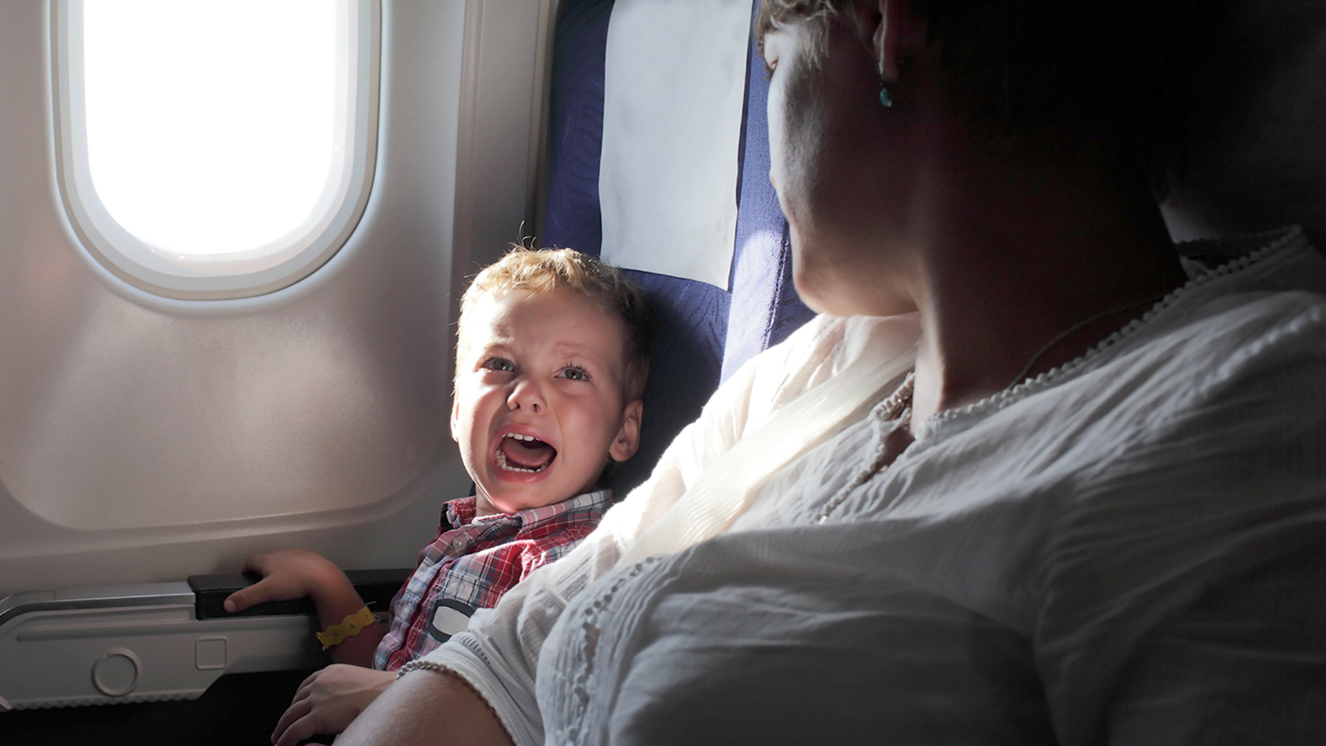 crying babby in airplane