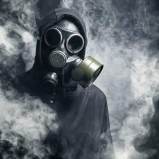 15912466-a-man-in-a-gas-mask-in-the-smoke-black-background
