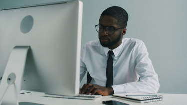 videoblocks-african-young-man-with-glasses-in-white-shirt-and-black-tie-working-in-office-african-man-shaking-hand-another-worker-indoor_rsrwtwcxb_thumbnail-full01