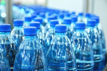 68212843 - closeup on mineral water green bottles in raw and lines