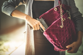 Woman Pulls A Gun From Her Swanky Purse. Conceal Carry Weapon Fo