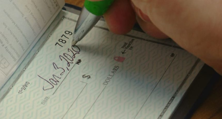 writing-2020-checks-hand-860x462-1