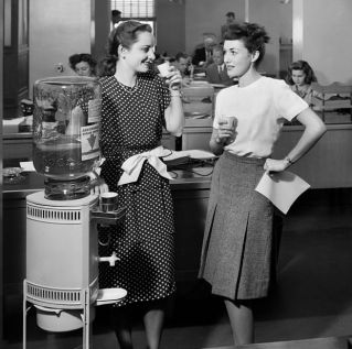 1940s-two-women-office-workers-standing-by-office-water-news-photo-1580932806