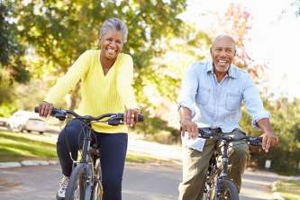 retired-couple-riding-bikes