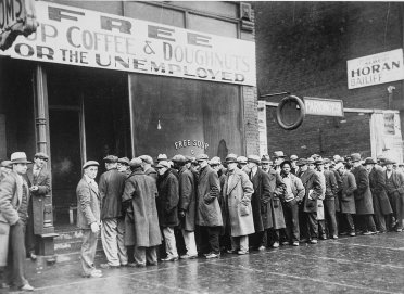 dustbowl_unemployed_men_queued_outside_a_depression_soup_kitchen_1931_-_nara.jpg__2000x1457_q85_crop_subsampling-2_upscale