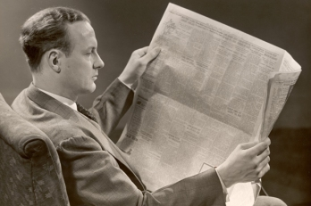 A Man Reads A Newspaper